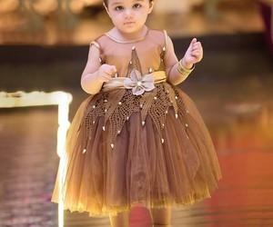 ملابس اطفال بنقشات مبهجة 1546974155071.jpg