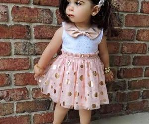 ملابس اطفال بنقشات مبهجة 1546974155082.jpg